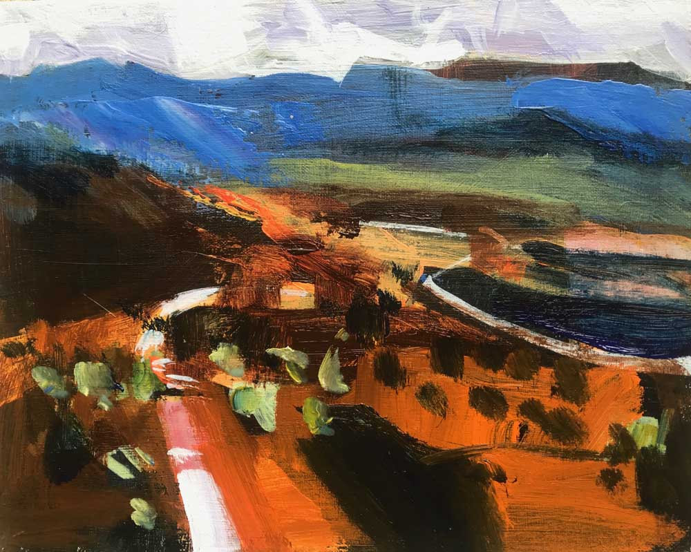 painting by Mike Staniford of a warm burnt orange landscape with golden highlights and blue mountains in the background